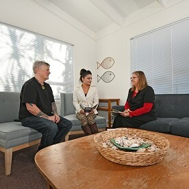 ACW117-Adults Talking Sitting-Indoors
